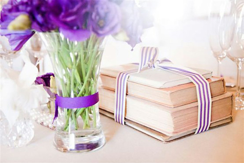 Centerpiece purple books and jar