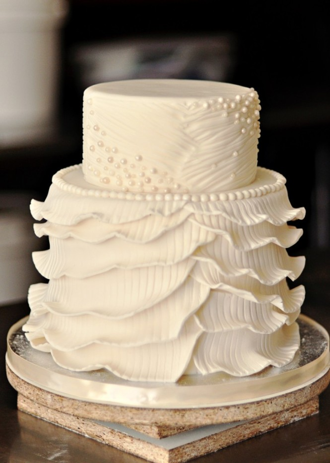 Cream ruffled wedding cake