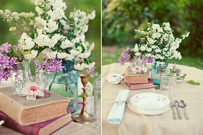 Table setting centerpiece with books and mason jars