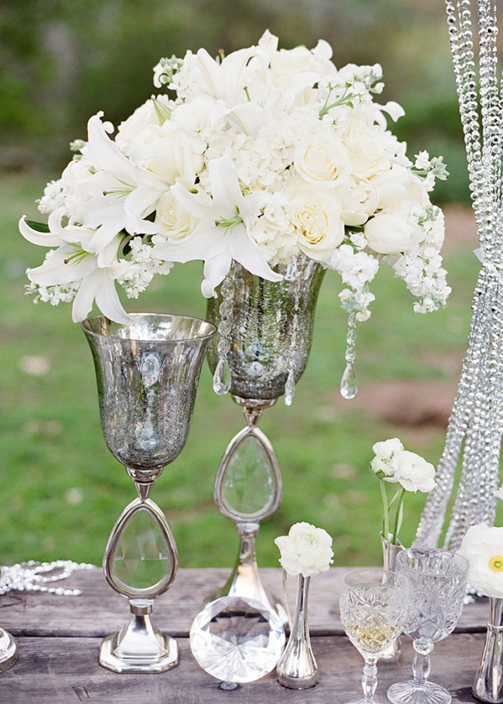 White flower centerpiece in silver vase